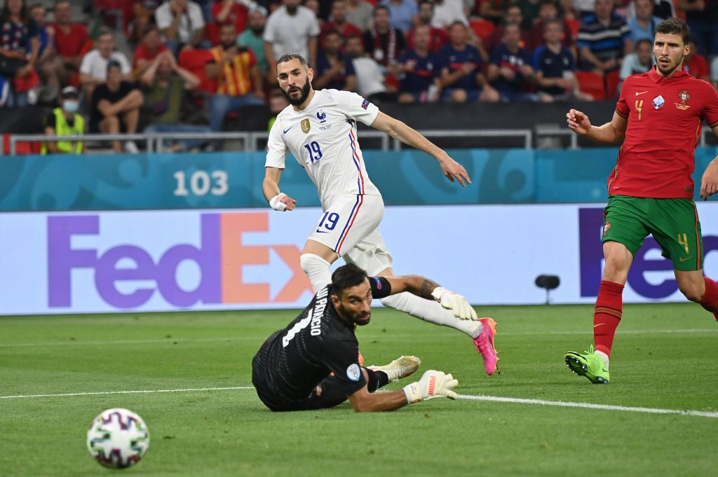 BUDAPEST, HUNGARY - JUNE 23: Karim Benzema of France celebrates after scoring their side's second goal during the UEFA Euro 2020 Championship Group F match between Portugal and France at Puskas Arena on June 23, 2021 in Budapest, Hungary. (Photo by Alex Pantling/Getty Images)