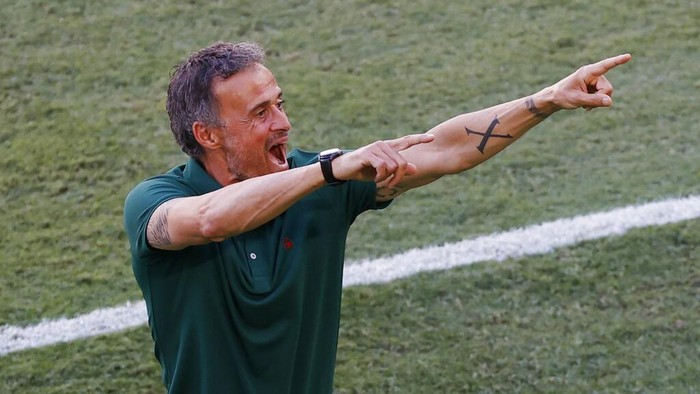 Spains manager Luis Enrique celebrates after Spains Aymeric Laporte scored his sides second goal during the Euro 2020 soccer championship group E match between Slovakia and Spain at La Cartuja Stadium in Seville, Spain, Wednesday June. 23, 2021. (Julio Munoz, Pool Photo via AP)