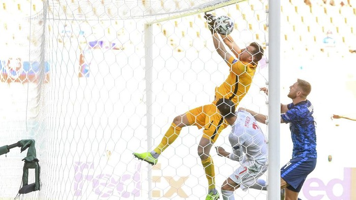 Slovakias goalkeeper Martin Dubravka scores an own-goal while attempting to clear the ball during the Euro 2020 soccer championship group E match between Slovakia and Spain at La Cartuja Stadium in Seville, Spain, Wednesday June. 23, 2021. (David Ramos, Pool photo via AP)