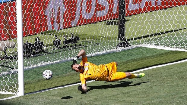 Slovakia's goalkeeper Martin Dubravka scores an own-goal while attempting to clear the ball during the Euro 2020 soccer championship group E match between Slovakia and Spain at La Cartuja Stadium in Seville, Spain, Wednesday June. 23, 2021. (David Ramos, Pool photo via AP)