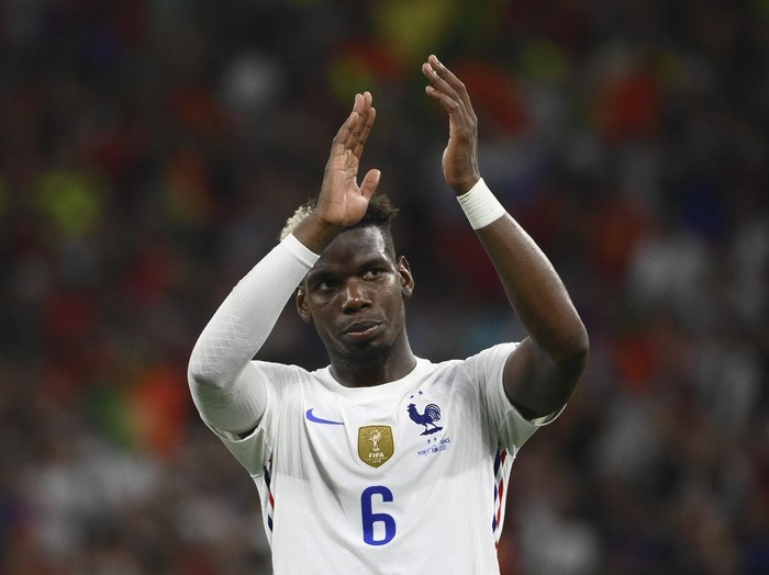 Frances Paul Pogba applauds the fans at the end of the Euro 2020 soccer championship group F match between Portugal and France at the Puskas Arena in Budapest, Wednesday, June 23, 2021. The game ended in a 2-2 draw. (Franck Fife, Pool photo via AP)