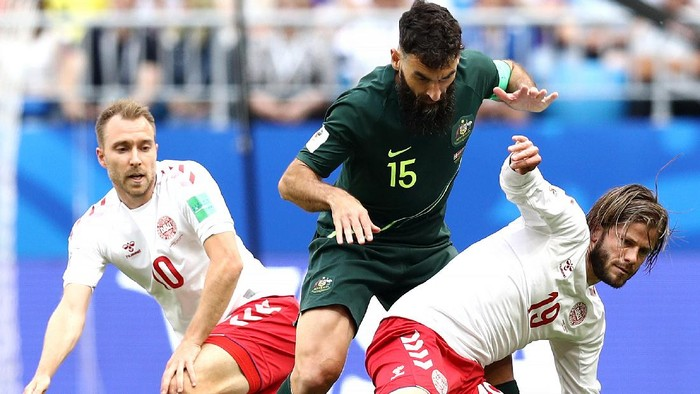 SAMARA, RUSSIA - JUNE 21:  Lasse Schone of Denmark is tackled by Mile Jedinak of Australia  during the 2018 FIFA World Cup Russia group C match between Denmark and Australia at Samara Arena on June 21, 2018 in Samara, Russia.  (Photo by Maddie Meyer/Getty Images)