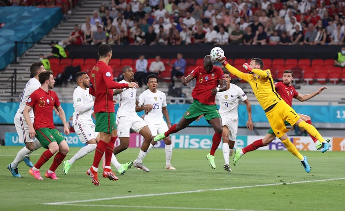 BUDAPEST, HUNGARY - JUNE 23: Danilo of Portugal is fouled by Hugo Lloris of France leading to a penalty being awarded during the UEFA Euro 2020 Championship Group F match between Portugal and France at Puskas Arena on June 23, 2021 in Budapest, Hungary. (Photo by Alex Pantling/Getty Images)