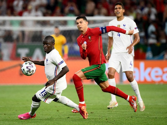 BUDAPEST, HUNGARY - JUNE 23: Cristiano Ronaldo of Portugal battles for possession with NGolo Kante of France during the UEFA Euro 2020 Championship Group F match between Portugal and France at Puskas Arena on June 23, 2021 in Budapest, Hungary. (Photo by Franck Fife - Pool/Getty Images)