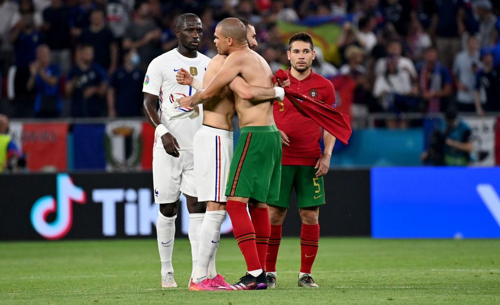 BUDAPEST, HUNGARY - JUNE 23: Karim Benzema of France interacts with Cristiano Ronaldo of Portugal during the UEFA Euro 2020 Championship Group F match between Portugal and France at Puskas Arena on June 23, 2021 in Budapest, Hungary. (Photo by Tibor Illyes - Pool/Getty Images)