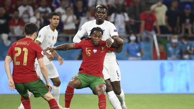 France's Paul Pogba, right, fights for the ball with Portugal's Renato Sanches during the Euro 2020 soccer championship group F match between Portugal and France at the Puskas Arena in Budapest, Wednesday, June 23, 2021. (Franck Fife, Pool photo via AP)