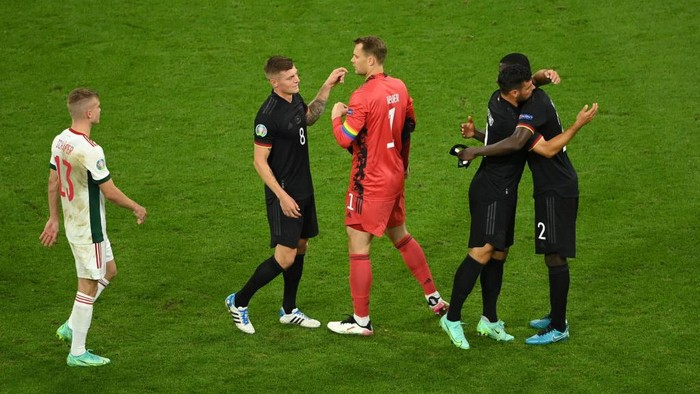 MUNICH, GERMANY - JUNE 23: Toni Kroos of Germany interacts with team mate Manuel Neuer after the UEFA Euro 2020 Championship Group F match between Germany and Hungary at Allianz Arena on June 23, 2021 in Munich, Germany. (Photo by Matthias Hangst/Getty Images)