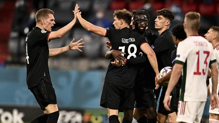 Germany players celebrate after scoring their sides first goal during the Euro 2020 soccer championship group F match between Germany and Hungary at the Allianz Arena in Munich, Germany,Wednesday, June 23, 2021. (Lukas Barth/Pool Photo via AP)