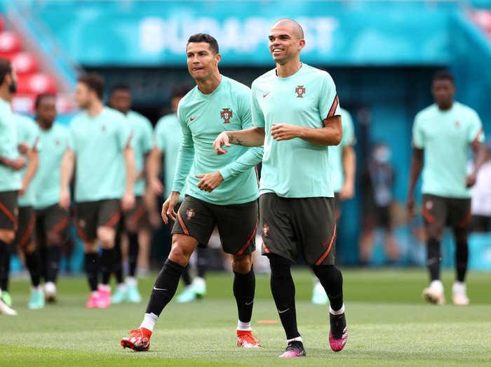 BUDAPEST, HUNGARY - JUNE 14: Cristiano Ronaldo shares a joke with Pepe during the Portugal Training Session ahead of the UEFA Euro 2020 Group F match between Hungary and Portugal at Puskas Arena on June 14, 2021 in Budapest, Hungary. (Photo by Alex Pantling/Getty Images)