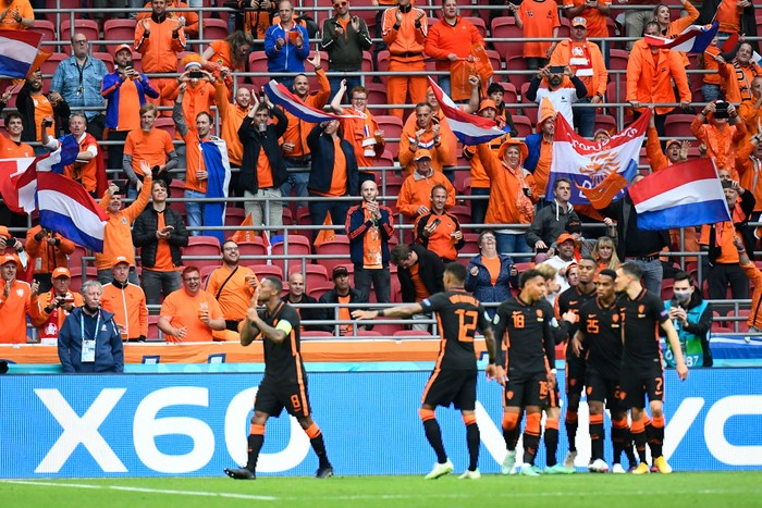 AMSTERDAM, NETHERLANDS - JUNE 21: Georginio Wijnaldum of Netherlands celebrates with teammates after scoring their sides second goal during the UEFA Euro 2020 Championship Group C match between North Macedonia and The Netherlands at Johan Cruijff Arena on June 21, 2021 in Amsterdam, Netherlands. (Photo by Piroshka van de Wouw - Pool/Getty Images)