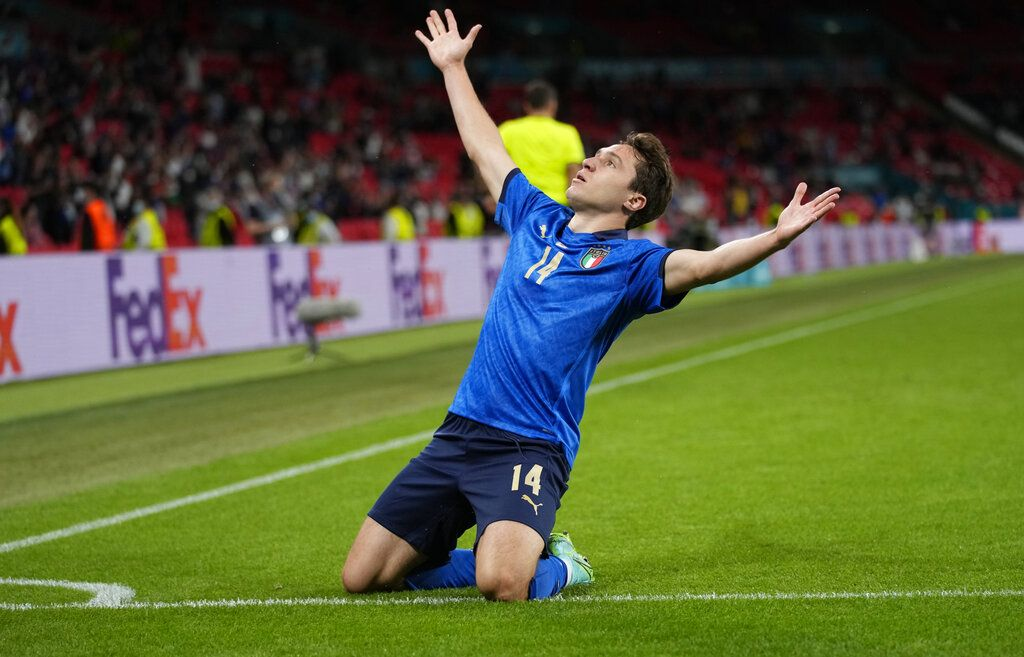 Italy's Federico Chiesa celebrates after scoring his side's opening goal during the Euro 2020 soccer championship round of 16 match between Italy and Austria at Wembley stadium in London, Saturday, June 26, 2021. (AP Photo/Frank Augstein, Pool)