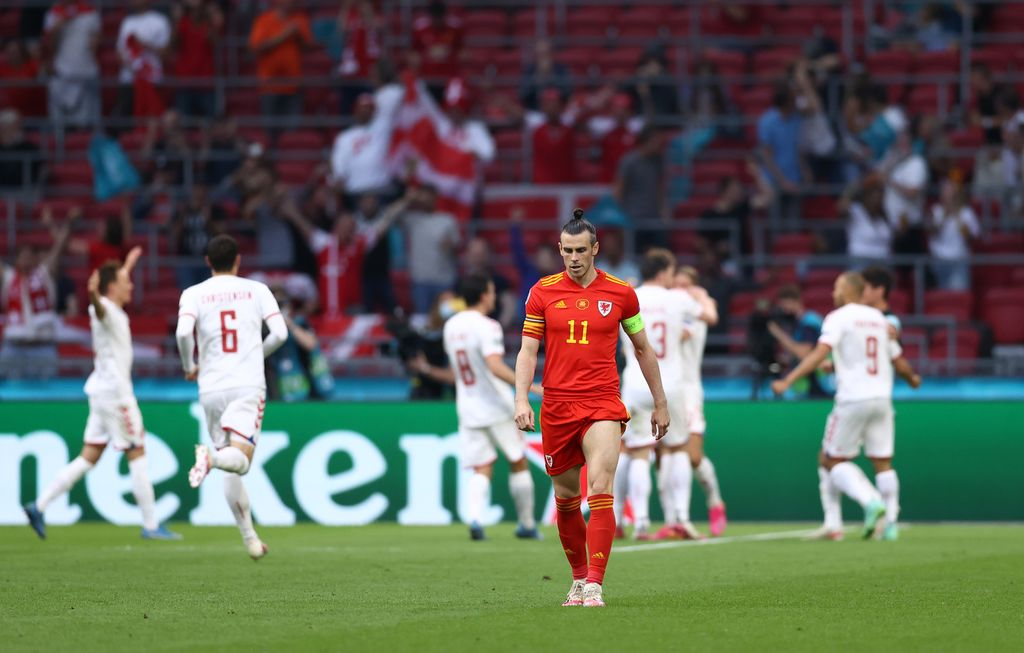 AMSTERDAM, NETHERLANDS - JUNE 26: Gareth Bale of Wales looks dejected after the Denmark second goal scored by Kasper Dolberg (Not pictured) of Denmark during the UEFA Euro 2020 Championship Round of 16 match between Wales and Denmark at Johan Cruijff Arena on June 26, 2021 in Amsterdam, Netherlands. (Photo by Dean Mouhtaropoulos/Getty Images)