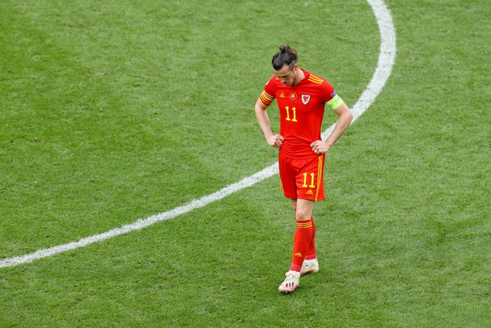 AMSTERDAM, NETHERLANDS - JUNE 26: Gareth Bale of Wales looks dejected as their side concedes a third goal scored by Joakim Maehle of Denmark (not pictured) during the UEFA Euro 2020 Championship Round of 16 match between Wales and Denmark at Johan Cruijff Arena on June 26, 2021 in Amsterdam, Netherlands. (Photo by Koen van Weel - Pool/Getty Images)
