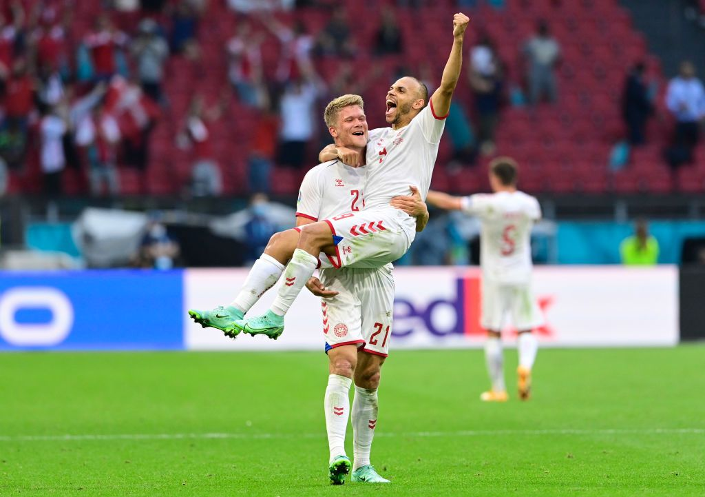 AMSTERDAM, NETHERLANDS - JUNE 26: Andreas Cornelius and Martin Braithwaite of Denmark celebrate their side's victory after the UEFA Euro 2020 Championship Round of 16 match between Wales and Denmark at Johan Cruijff Arena on June 26, 2021 in Amsterdam, Netherlands. (Photo by Olaf Kraak - Pool/Getty Images)
