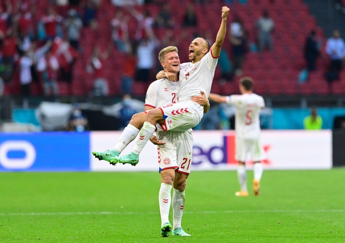 AMSTERDAM, NETHERLANDS - JUNE 26: Andreas Cornelius and Martin Braithwaite of Denmark celebrate their sides victory after the UEFA Euro 2020 Championship Round of 16 match between Wales and Denmark at Johan Cruijff Arena on June 26, 2021 in Amsterdam, Netherlands. (Photo by Olaf Kraak - Pool/Getty Images)
