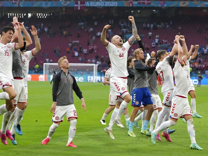 Denmarks players celebrate after the Euro 2020 soccer championship round of 16 match between Wales and Denmark at Johan Cruyff ArenA in Amsterdam, Netherlands, Saturday, June 26, 2021. (AP Photo/Peter Dejong, Pool)