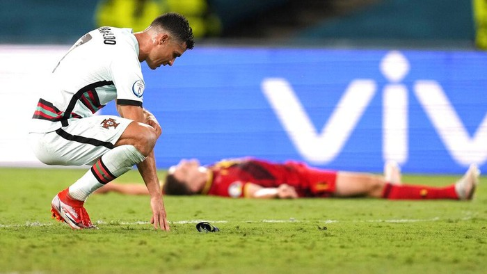 Portugals Cristiano Ronaldo reacts during the Euro 2020 soccer championship round of 16 match between Belgium and Portugal at the La Cartuja stadium in Seville, Spain,Sunday, June 27, 2021. (AP Photo/Thanassis Stavrakis, Pool)