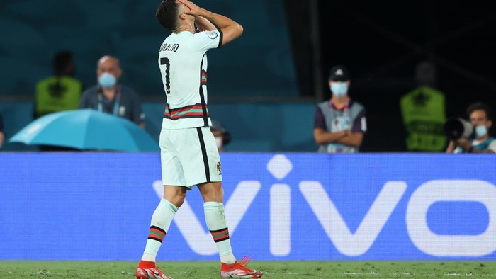 SEVILLE, SPAIN - JUNE 27: Cristiano Ronaldo of Portugal looks dejected following defeat in the UEFA Euro 2020 Championship Round of 16 match between Belgium and Portugal at Estadio La Cartuja on June 27, 2021 in Seville, Spain. (Photo by Alexander Hassenstein/Getty Images)