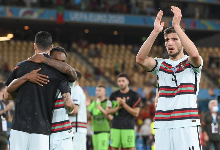 Portugals Ruben Dias thanks supporters following the Euro 2020 soccer championship round of 16 match between Belgium and Portugal at La Cartuja stadium, Seville, Spain, Sunday, June 27, 2021. (Lluis Gene/Pool Photo via AP)