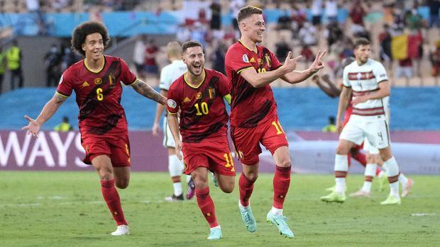 Soccer Football - Euro 2020 - Round of 16 - Belgium v Portugal - La Cartuja Stadium, Seville, Spain - June 27, 2021  Belgium's Thorgan Hazard celebrates scoring their first goal Pool via REUTERS/Thanassis Stavrakis