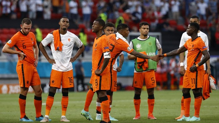 Players of Netherlands after the Euro 2020 soccer championship round of 16 match between Netherlands and Czech Republic at the Ferenc Puskas stadium in Budapest, Hungary, Sunday, June 27, 2021. (Bernadet Szabo/Pool via AP)