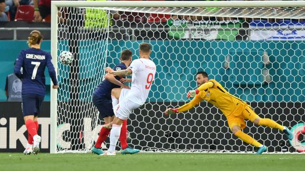 BUCHAREST, ROMANIA - JUNE 28: Haris Seferovic of Switzerland scores their side's first goal past Hugo Lloris of France during the UEFA Euro 2020 Championship Round of 16 match between France and Switzerland at National Arena on June 28, 2021 in Bucharest, Romania. (Photo by Justin Setterfield/Getty Images)