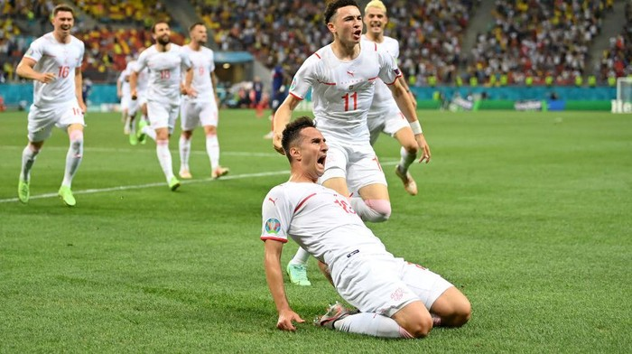 BUCHAREST, ROMANIA - JUNE 28: Mario Gavranovic of Switzerland celebrates after scoring their sides third goal during the UEFA Euro 2020 Championship Round of 16 match between France and Switzerland at National Arena on June 28, 2021 in Bucharest, Romania. (Photo by Justin Setterfield/Getty Images)