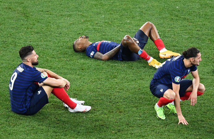 BUCHAREST, ROMANIA - JUNE 28: (L - R) Olivier Giroud, Presnel Kimpembe and Adrien Rabiot of France look dejected after losing in the penalty shoot out in the UEFA Euro 2020 Championship Round of 16 match between France and Switzerland at National Arena on June 28, 2021 in Bucharest, Romania. (Photo by Mihai Barbu - Pool/Getty Images)