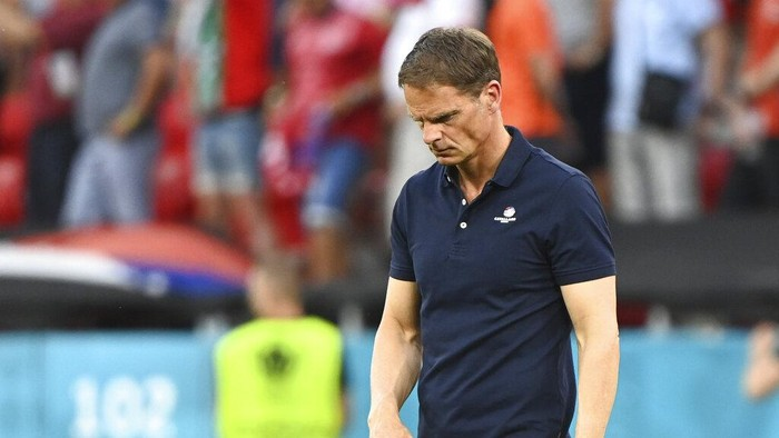 Netherlands coach Frank de Boer looks dejected after the Euro 2020 soccer championship round of 16 match between the Netherlands and Czech Republic at the Puskas Arena in Budapest, Hungary, Sunday, June 27, 2021. (Attila Kisbenedek/Pool via AP)