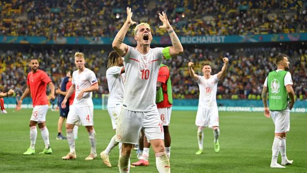 BUCHAREST, ROMANIA - JUNE 28: Granit Xhaka of Switzerland celebrates their side's victory in the penalty shoot out after the UEFA Euro 2020 Championship Round of 16 match between France and Switzerland at National Arena on June 28, 2021 in Bucharest, Romania. (Photo by Justin Setterfield/Getty Images)
