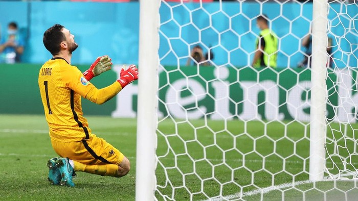 Frances goalkeeper Hugo Lloris reacts after fails to save a penalty shot during the shoot-out during the Euro 2020 soccer championship round of 16 match between France and Switzerland at the National Arena stadium, in Bucharest, Romania, Tuesday, June 29, 2021. (Marko Djurica/Pool Photo via AP)
