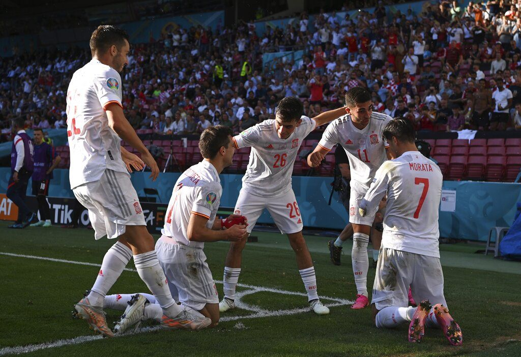 Spain's Cesar Azpilicueta, second left, celebrates after scoring his side's second goal during the Euro 2020 soccer championship round of 16 match between Croatia and Spain at Parken stadium in Copenhagen, Denmark, Monday, June 28, 2021.(AP Photo/Jonathan Nackstrand, Pool)