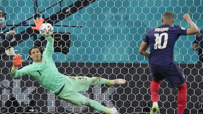 Switzerlands goalkeeper Yann Sommer saves the penalty shot by Frances Kylian Mbappe during the Euro 2020 soccer championship round of 16 match between France and Switzerland at the National Arena stadium in Bucharest, Romania, Tuesday, June 29, 2021. (AP Photo/Vadim Ghirda, Pool)