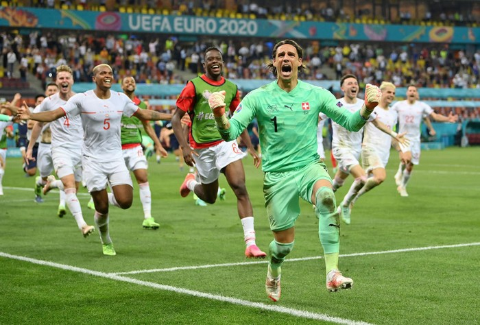 BUCHAREST, ROMANIA - JUNE 28: cr of Switzerland celebrates after saving the decisive penalty taken by Kylian Mbappe of France (Not pictured) during the UEFA Euro 2020 Championship Round of 16 match between France and Switzerland at National Arena on June 28, 2021 in Bucharest, Romania. (Photo by Justin Setterfield/Getty Images)