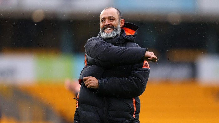 WOLVERHAMPTON, ENGLAND - MAY 23: Nuno Espirito Santo, Manager of Wolverhampton Wanderers celebrates with the fans after his last match following the Premier League match between Wolverhampton Wanderers and Manchester United at Molineux on May 23, 2021 in Wolverhampton, England. A limited number of fans will be allowed into Premier League stadiums as Coronavirus restrictions begin to ease in the UK. (Photo by Catherine Ivill/Getty Images)