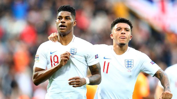 GUIMARAES, PORTUGAL - JUNE 06:  Marcus Rashford of England celebrates as he scores his team's first goal from a penalty with Jadon Sancho during the UEFA Nations League Semi-Final match between the Netherlands and England at Estadio D. Afonso Henriques on June 06, 2019 in Guimaraes, Portugal. (Photo by Dean Mouhtaropoulos/Getty Images)