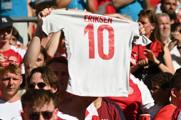 COPENHAGEN, DENMARK - JUNE 17: A Denmark shirt with Christian Eriksen, Number Ten is raised in the crowd prior to the UEFA Euro 2020 Championship Group B match between Denmark and Belgium at Parken Stadium on June 17, 2021 in Copenhagen, Denmark. (Photo by Jonathan Nackstrand - Pool/Getty Images)