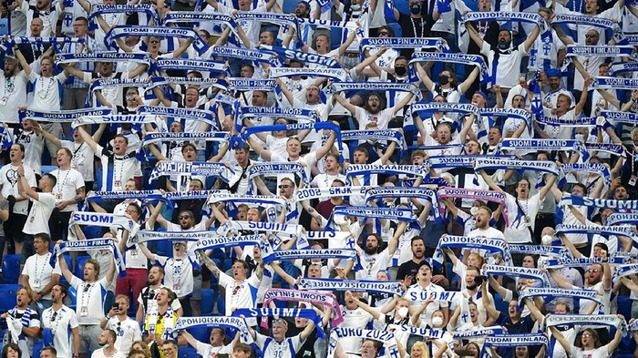 Fans of Finland sing the national anthem of their country before the Euro 2020 soccer championship group B match between Finland and Belgium at Saint Petersburg stadium, in St. Petersburg, Russia, Monday, June 21, 2021. (AP Photo/Dmitri Lovetsky, Pool)