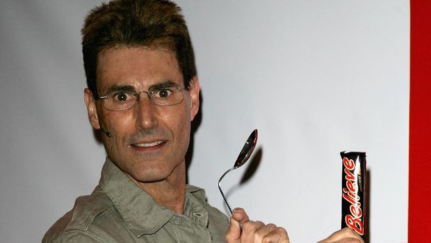 LONDON - JUNE 07:  Uri Geller poses at 'Believe-athon' on June 07, 2006 in London, England. Uri Geller was commissioned by Mars, re-named MARS Believe for the duration of the world cup. He held the Believe-athon to inspire positive thinking for England fans and to help the England team win the world cup.  (Photo by Gareth Cattermole/Getty Images)