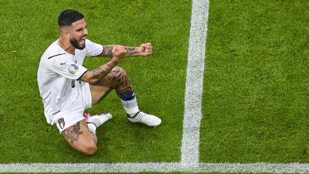 Italy's Lorenzo Insigne celebrates after scoring his team's second goal during the Euro 2020 soccer championship quarterfinal match between Belgium and Italy at the Allianz Arena in Munich, Germany, Friday, July 2, 2021. (Stuart Franklin/Pool Photo via AP)