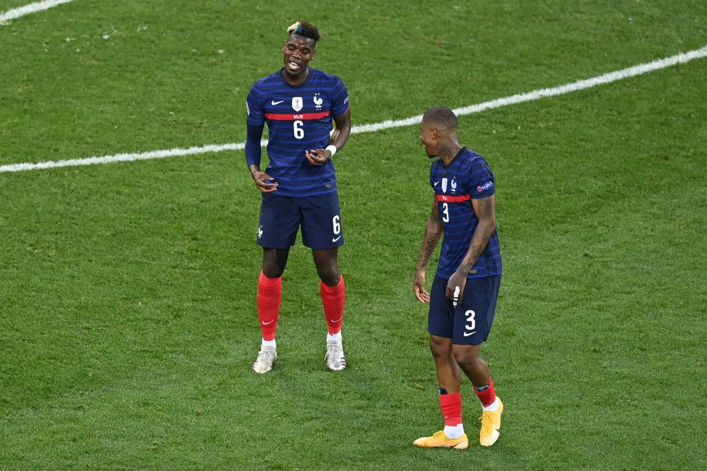BUCHAREST, ROMANIA - JUNE 28: Paul Pogba of France celebrates with Presnel Kimpembe after scoring their side's third goal during the UEFA Euro 2020 Championship Round of 16 match between France and Switzerland at National Arena on June 28, 2021 in Bucharest, Romania. (Photo by Mihai Barbu - Pool/Getty Images)