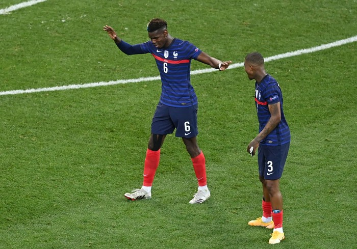 BUCHAREST, ROMANIA - JUNE 28: Paul Pogba of France celebrates with Presnel Kimpembe after scoring their sides third goal during the UEFA Euro 2020 Championship Round of 16 match between France and Switzerland at National Arena on June 28, 2021 in Bucharest, Romania. (Photo by Mihai Barbu - Pool/Getty Images)