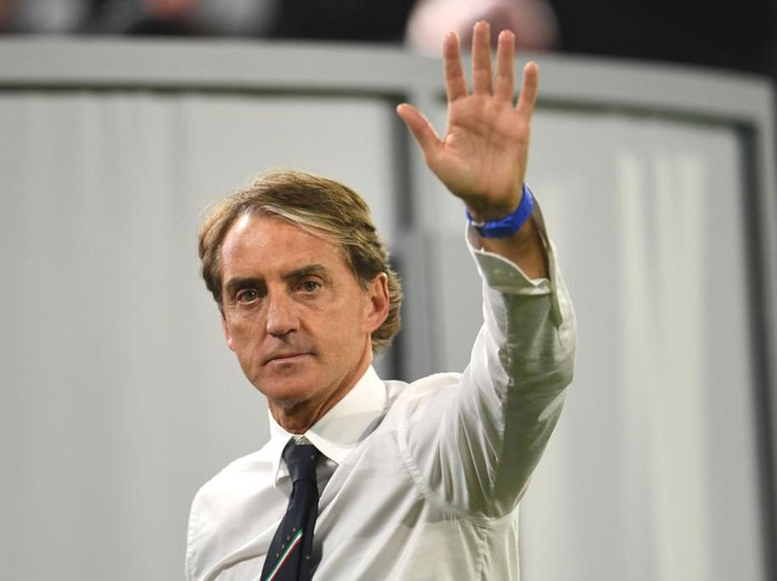 MUNICH, GERMANY - JULY 02: Roberto Mancini, Head Coach of Italy reacts following victory in the UEFA Euro 2020 Championship Quarter-final match between Belgium and Italy at Football Arena Munich on July 02, 2021 in Munich, Germany. (Photo by Andreas Geber - Pool/Getty Images)
