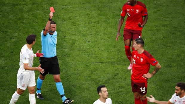Referee shows a red card to Switzerland's Remo Freuler, not pictured, during the Euro 2020 soccer championship quarterfinal match between Switzerland and Spain at Saint Petersburg Stadium in St. Petersburg, Russia, Friday, July 2, 2021. (Anton Vaganov/Pool via AP)