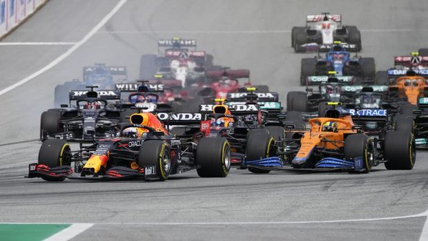 Red Bull driver Max Verstappen of the Netherlands, center, steers his car during the start of the Austrian Formula One Grand Prix at the Red Bull Ring racetrack in Spielberg, Austria, Sunday, July 4, 2021. (AP Photo/Darko Bandic)