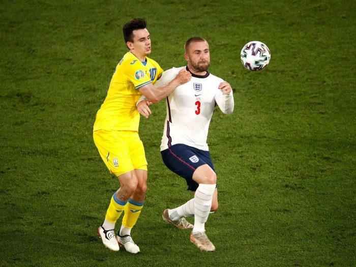 ROME, ITALY - JULY 03: Luke Shaw of England clears the ball whilst under pressure from Mykola Shaparenko of Ukraine during the UEFA Euro 2020 Championship Quarter-final match between Ukraine and England at Olimpico Stadium on July 03, 2021 in Rome, Italy. (Photo by Alessandro Garafallo - Pool/Getty Images)