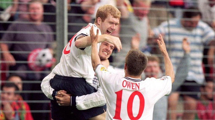12 Jun 2000:  Paul Scholes is congratulated by England teammates David Beckham and Michael Owen during the European Championships 2000 group match against Portugal at the Philips Stadium in Eindhoven, Holland.  Portugal won the match 3-2.  Mandatory Credit: Ben Radford /Allsport