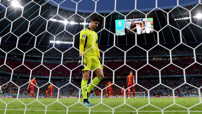 MUNICH, GERMANY - JULY 02: Thibaut Courtois of Belgium looks dejected after the Italy first goal scored by Nicolo Barella during the UEFA Euro 2020 Championship Quarter-final match between Belgium and Italy at Football Arena Munich on July 02, 2021 in Munich, Germany. (Photo by Matthias Hangst/Getty Images)