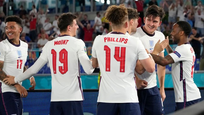 ROME, ITALY - JULY 03: Harry Maguire of England celebrates with John Stones and Raheem Sterling after scoring their sides second goal during the UEFA Euro 2020 Championship Quarter-final match between Ukraine and England at Olimpico Stadium on July 03, 2021 in Rome, Italy. (Photo by Alessandra Tarantino - Pool/Getty Images)