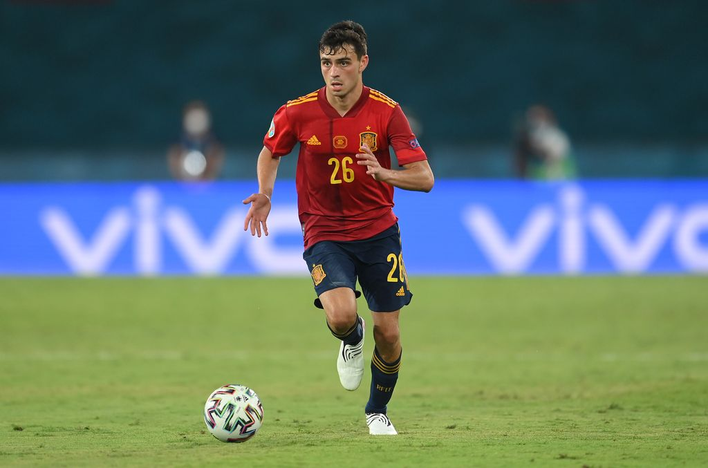 SEVILLE, SPAIN - JUNE 14: Pedri of Spain runs with the ball during the UEFA Euro 2020 Championship Group E match between Spain and Sweden at the La Cartuja Stadium on June 14, 2021 in Seville, Spain. (Photo by David Ramos/Getty Images)